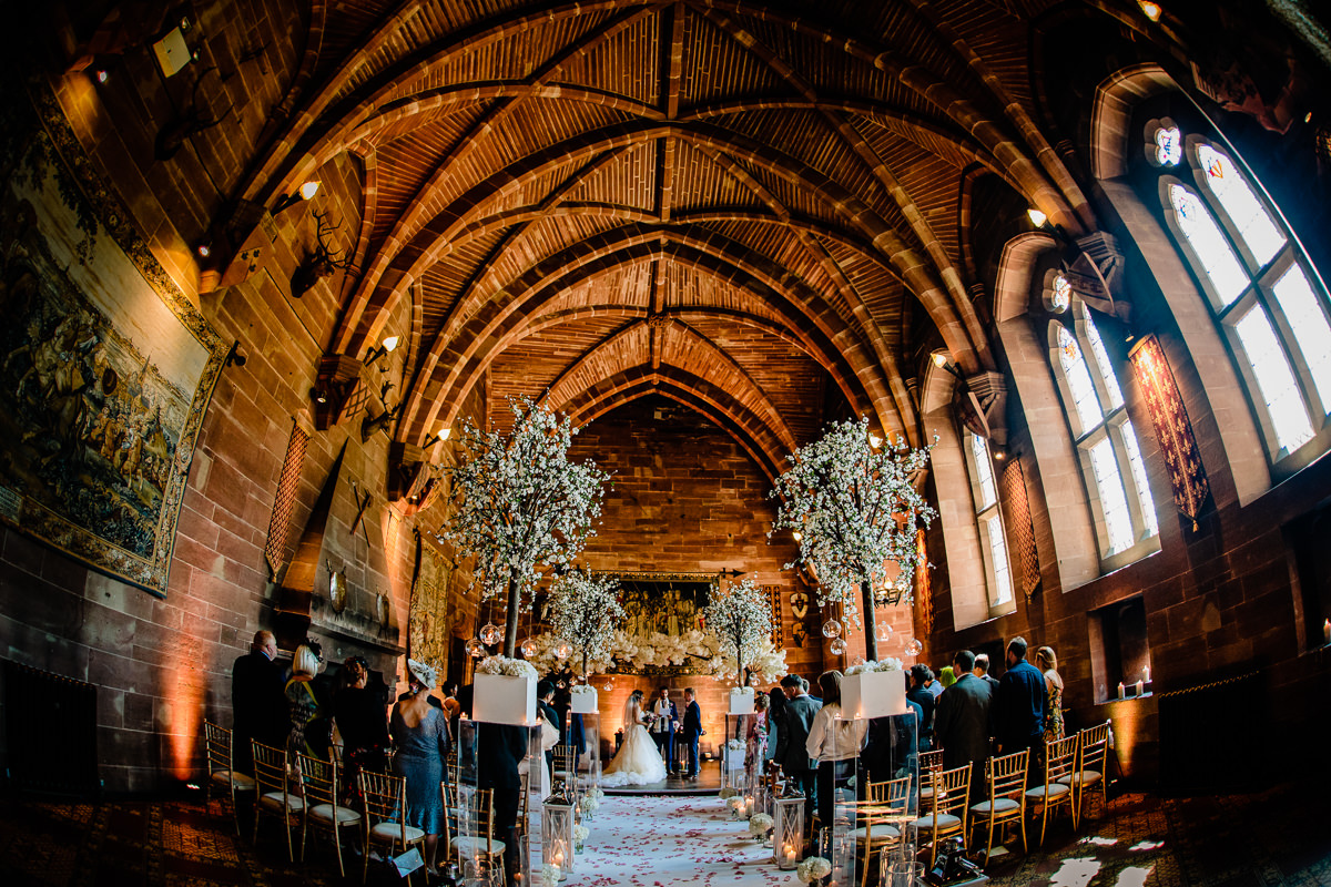 Wedding ceremony taking place in the Great Hall at Peckforton Castle
