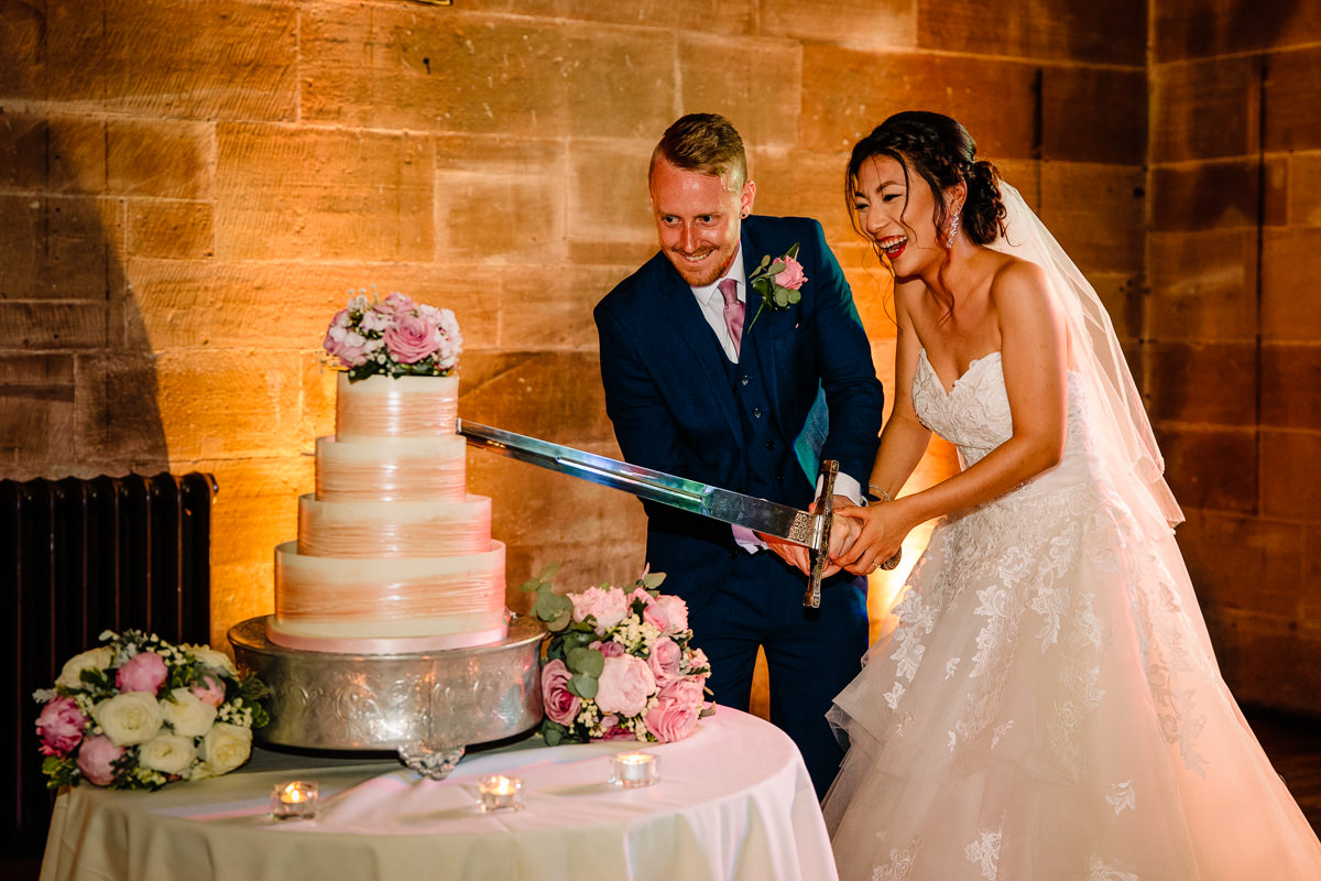 Wedding Cake cutting fun with a sword at Peckforton Castle