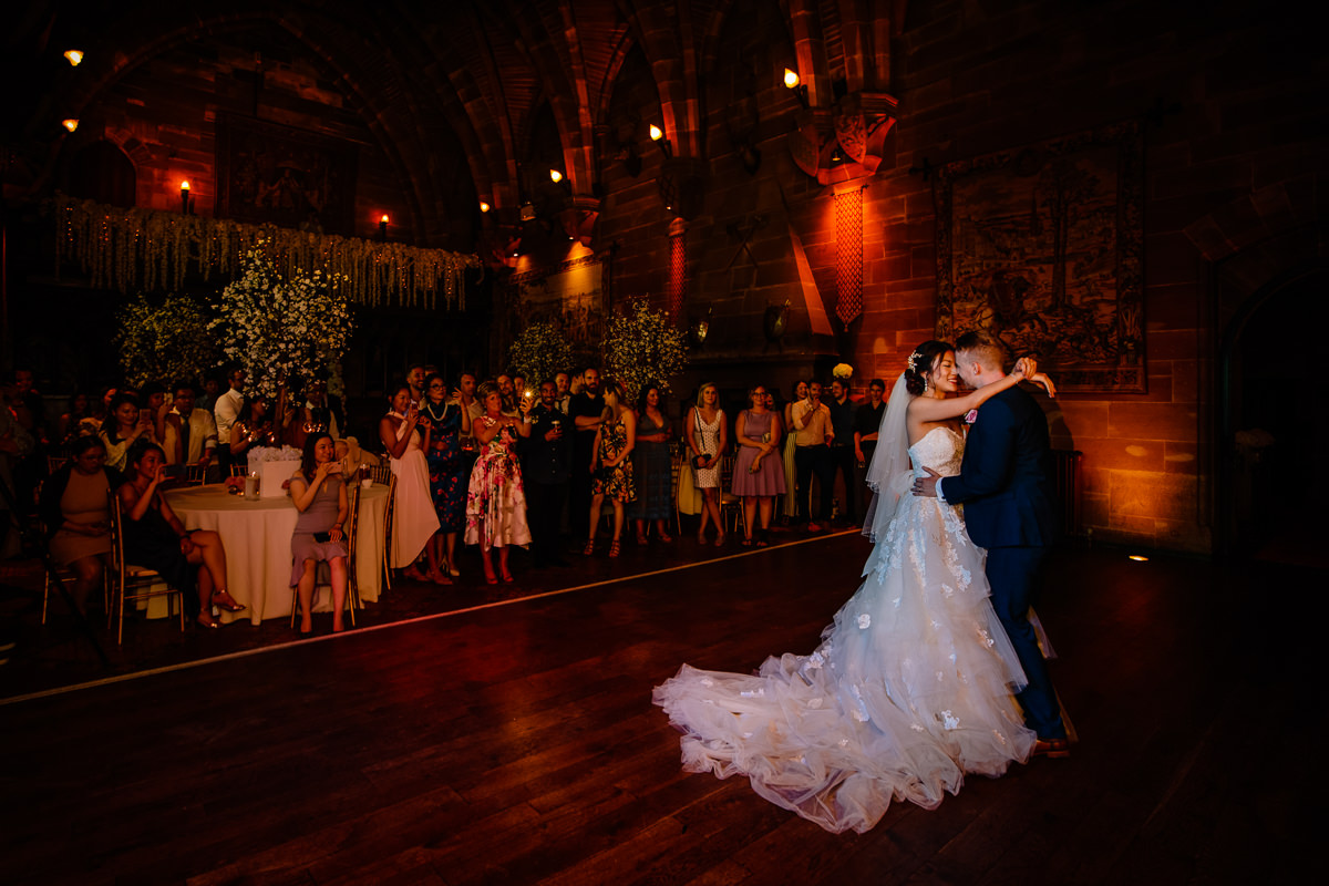 Bride and groom having their first dance at Peckforton Castle
