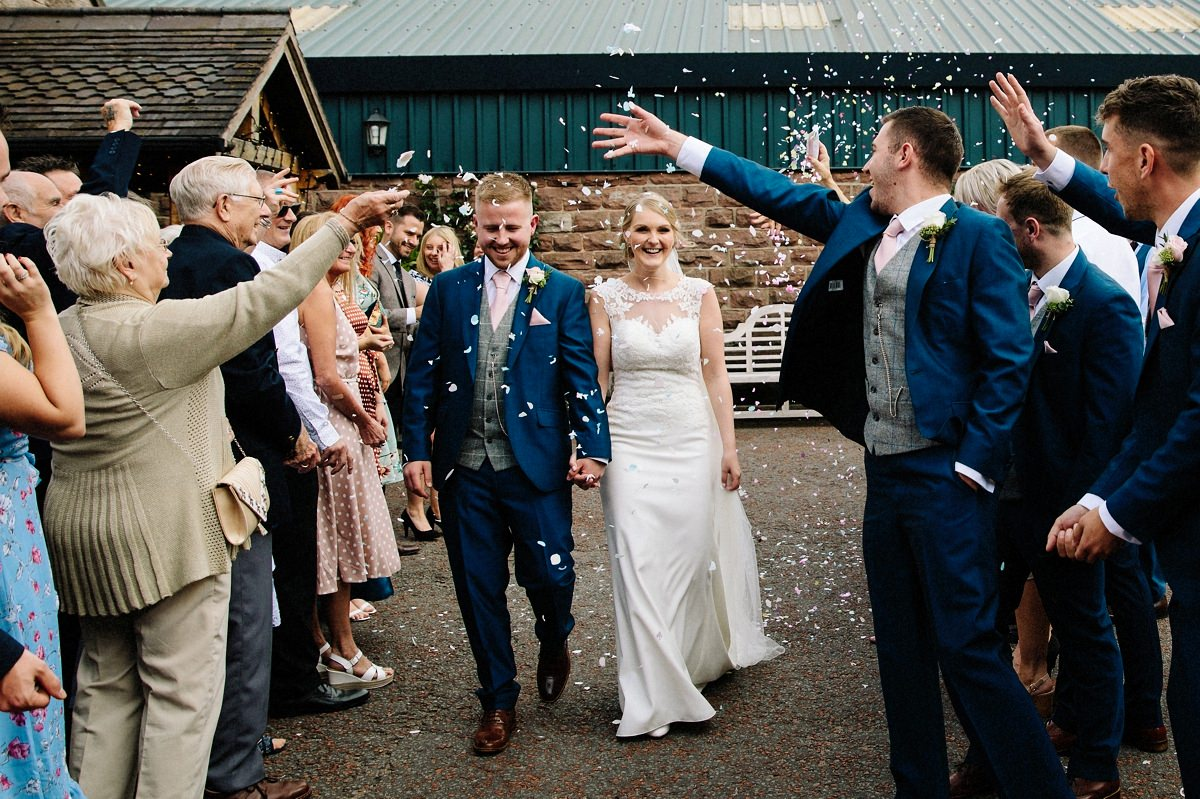 Confetti being thrown at the bride and groom at Heaton House Farm