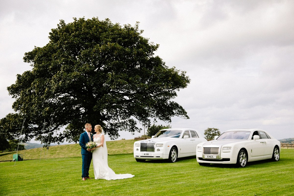 Heaton House Farm with the bride and groom and two wedding cars