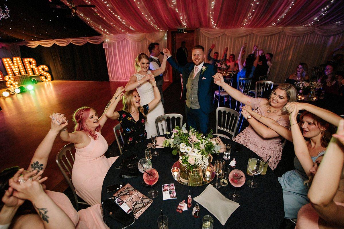 Singing and dancing at the wedding at Heaton House Farm