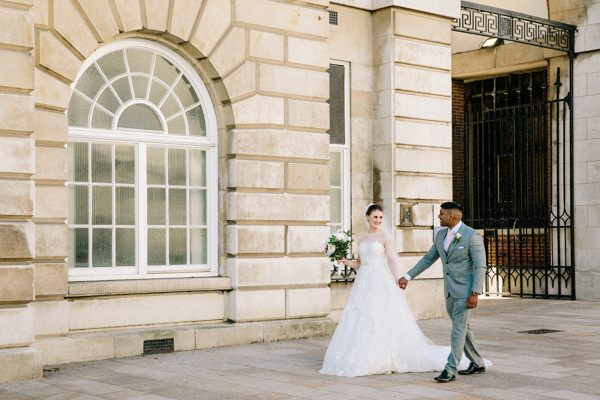 Bride & Groom walking hand in hand in Liverpool