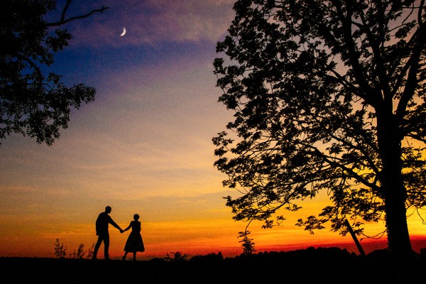 Sunset with silhouette of the Bride and Groom