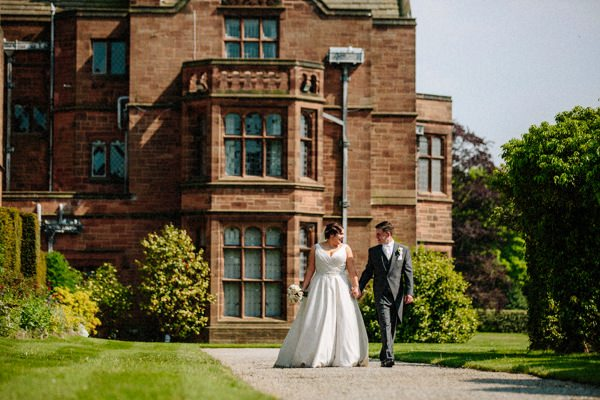 Thornton Manor wedding with the Bride and Groom walking in the gardens