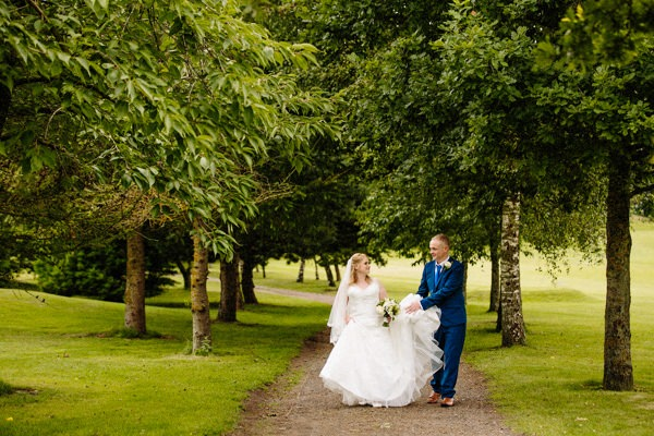 Bride and Groom walking together at Hartford Golf Club wedding venue in Cheshire