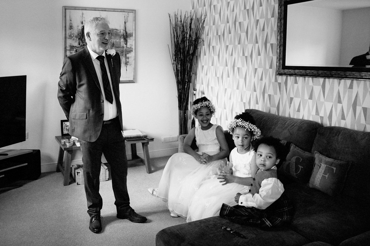 Dad, Flower Girls and Page boy waiting for the Bride in black & white