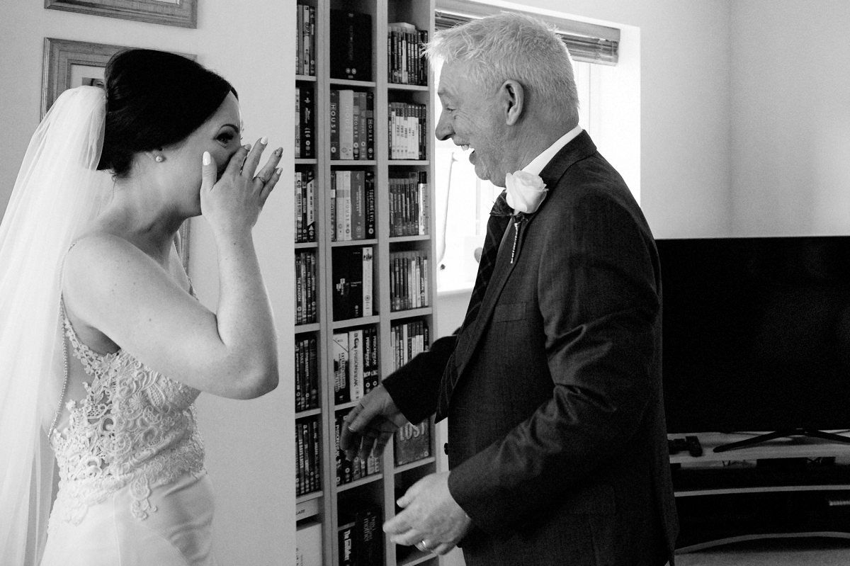 Bride with happy tears after seeing her dad on the morning of the wedding