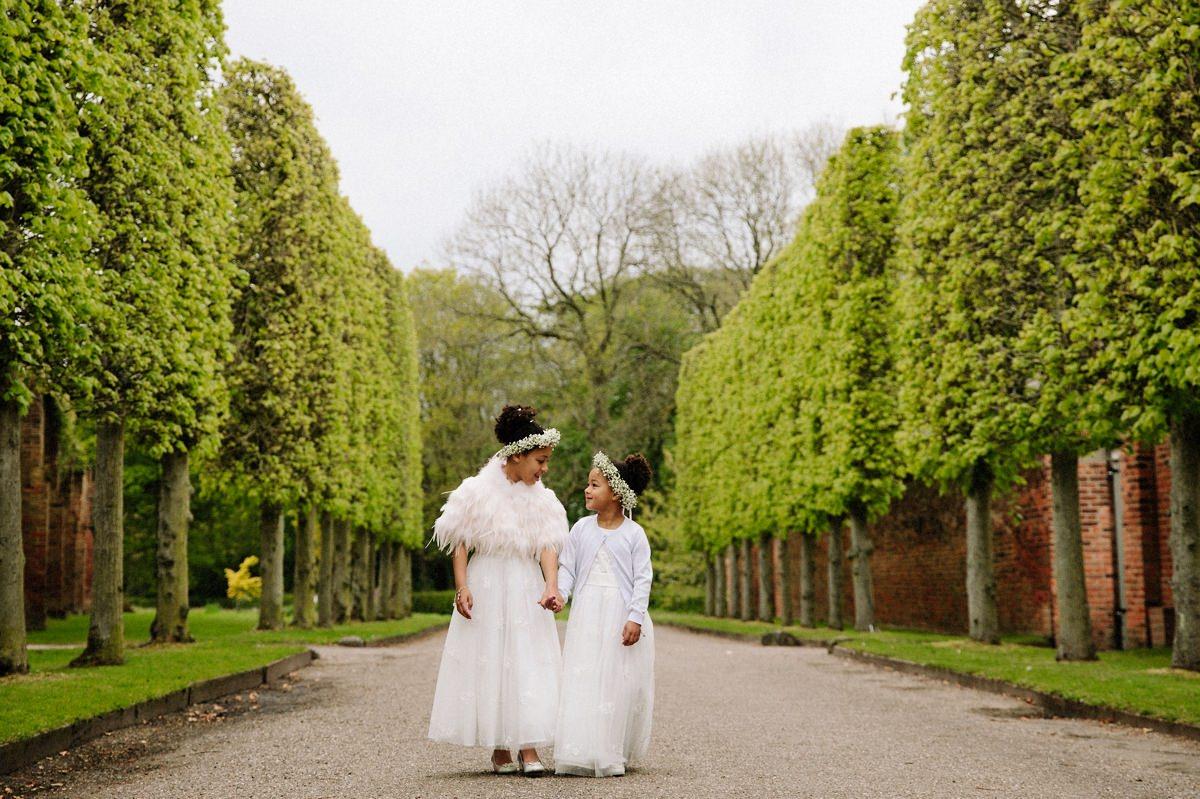 Lovely Flower girls holding hands at Arley Hall Gardens