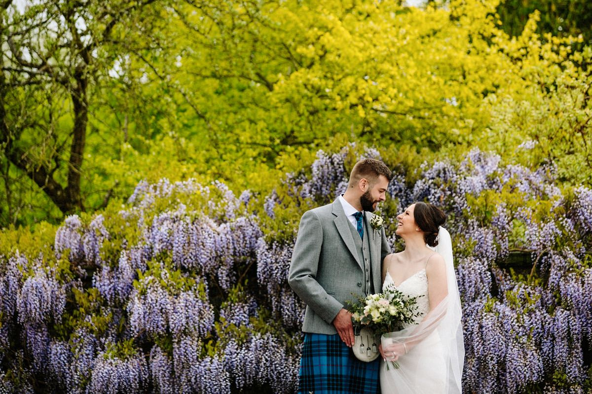 Bride and groom in the gardens at Arley Hall