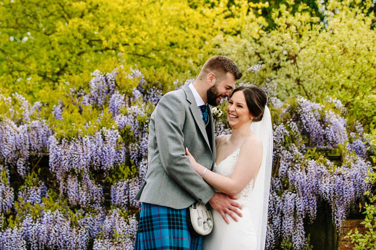 Natural moment captured between the bride and groom at Arley Hall gardens