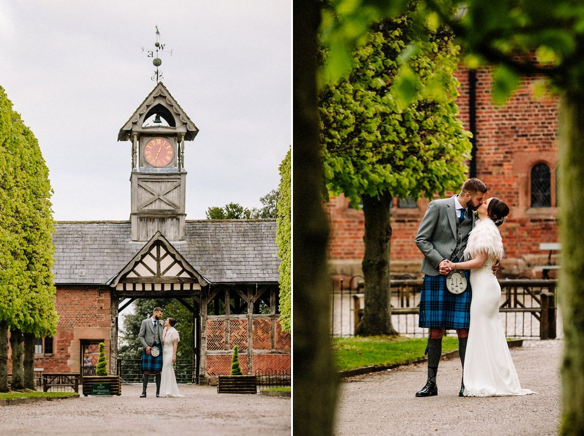 Bride and groom in front of the clock tower at Arley Hall