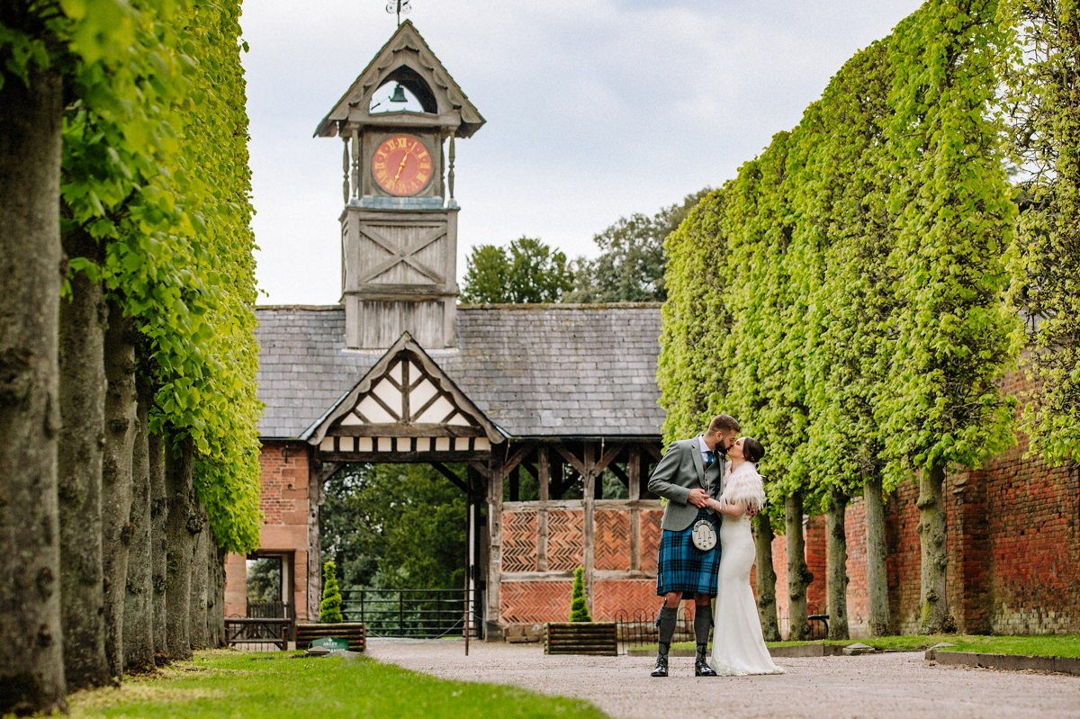 The Clock Tower at Arley Hall with the bride and groom