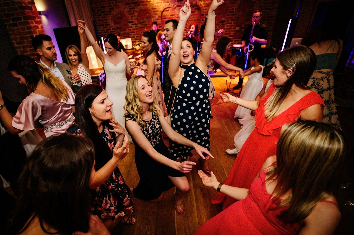 Wedding guests having lots of fun on the dance floor at Arley Hall in the Olympia room