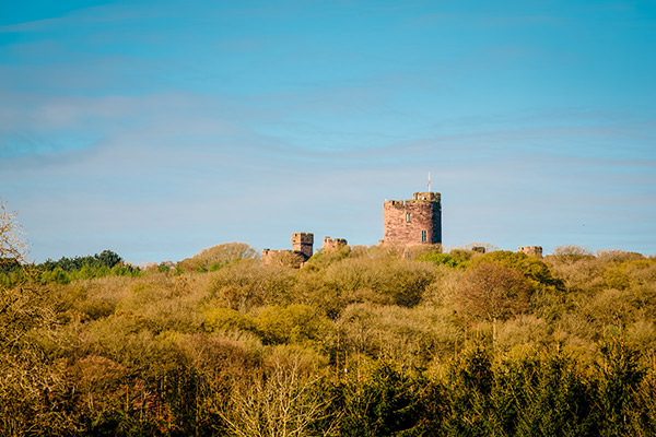 Peckforton Castle Cheshire view of the castle from the trees