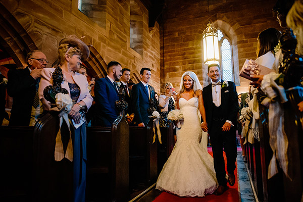 The Chapel at Peckforton Castle during a ceremony with the bride and groom walking down the aisle