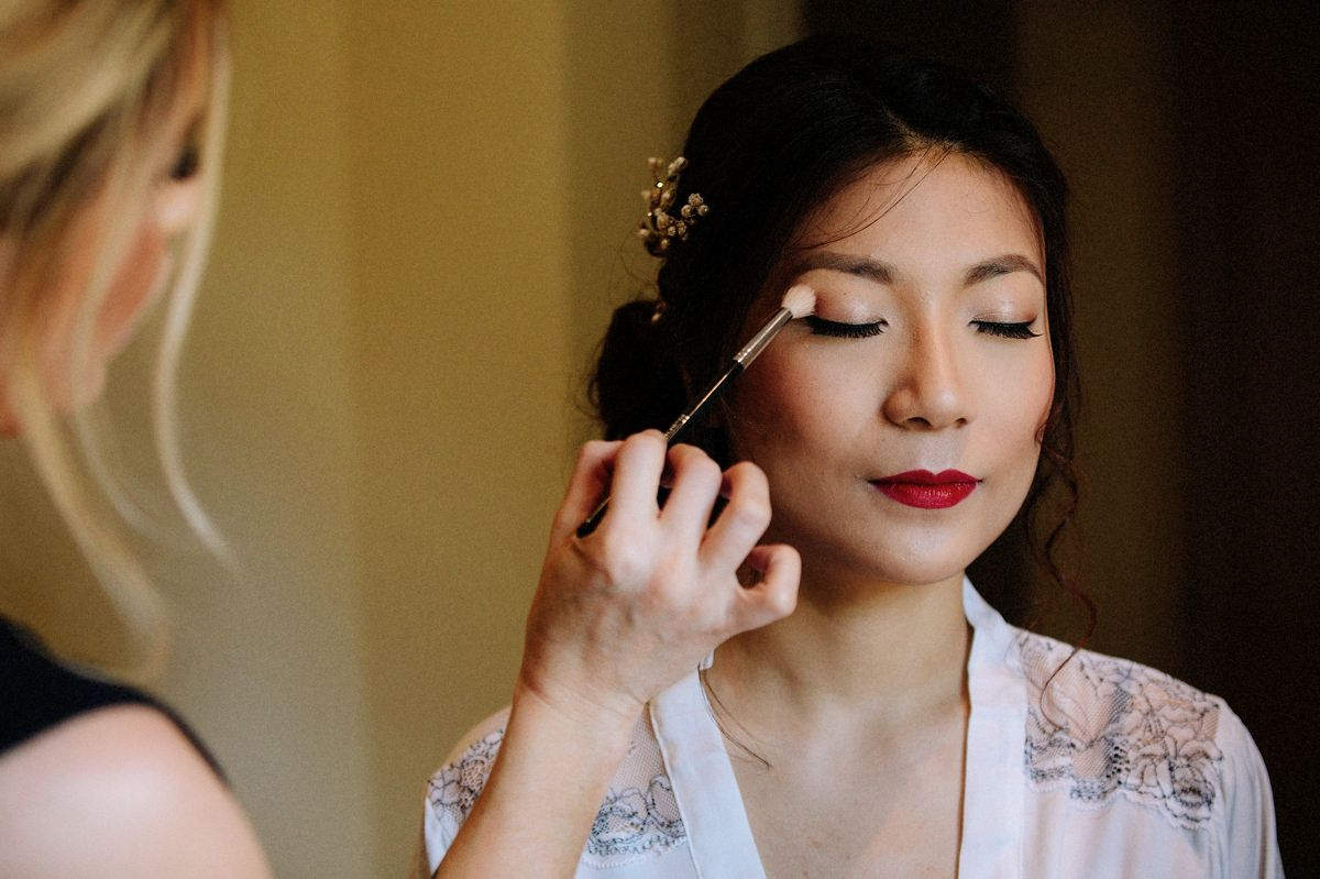 Bride having her make up applied before she gets married