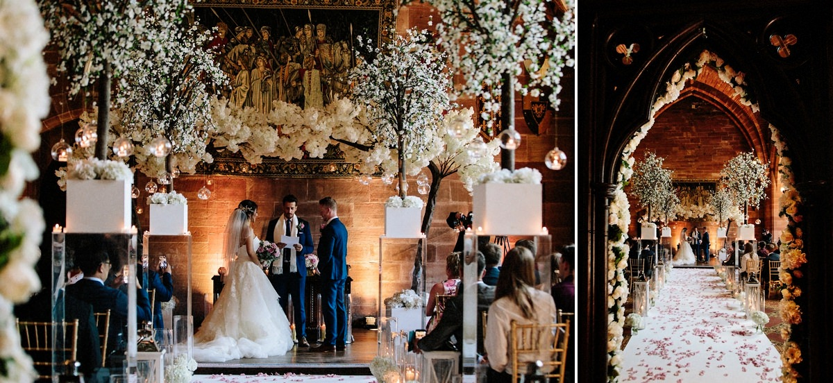 Wedding Ceremony with floral displays and candles at Peckforton Castle