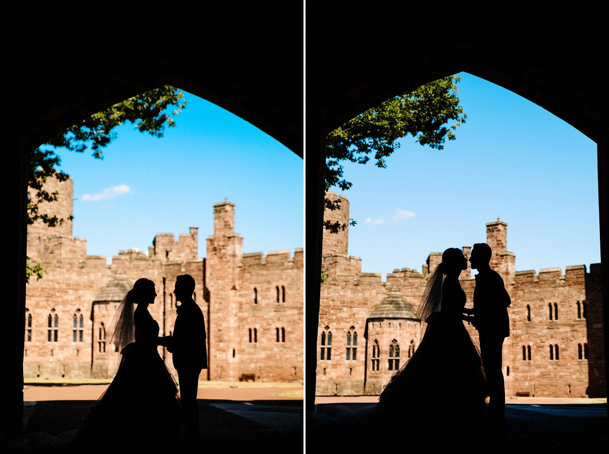 silhouette with the bride and groom under the drawbridge at Peckforton Castle