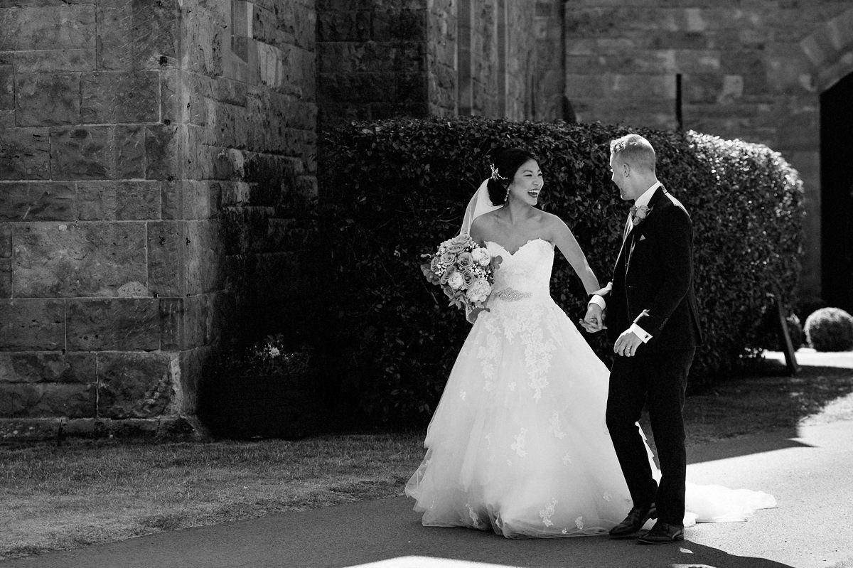 Natural fun moment with the bride and groom at Peckforton Castle