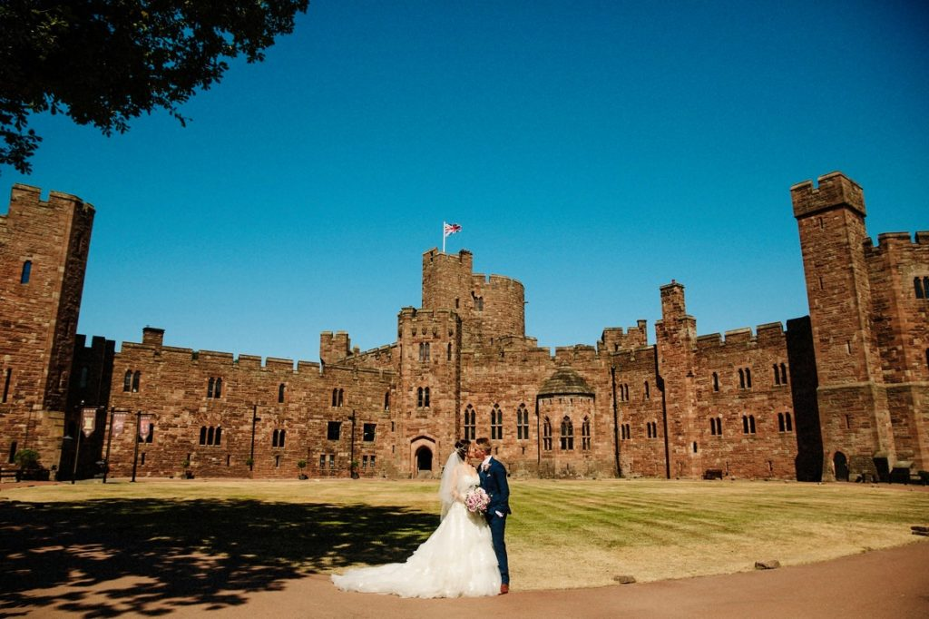 Peckforton Castle on a beautiful sunny day with the bride and groom