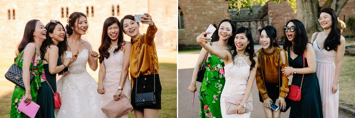 Bride and her wedding guests taking selfies