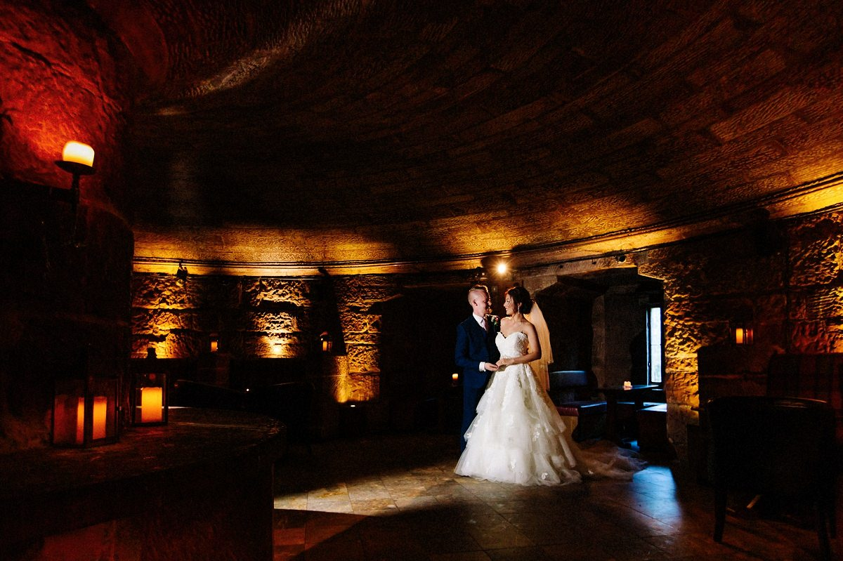 The Wine Cellar at Peckforton Castle with the bride and groom