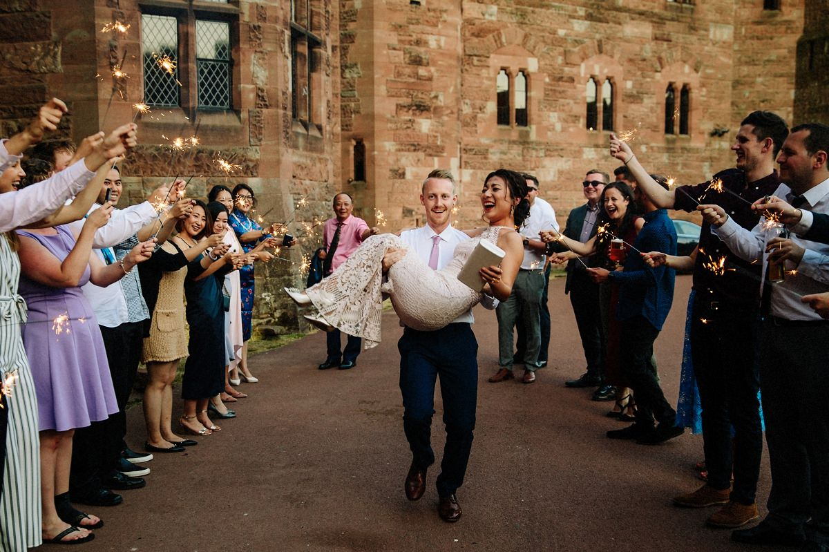 Sparkler exit at Peckforton Castle with the bride and groom
