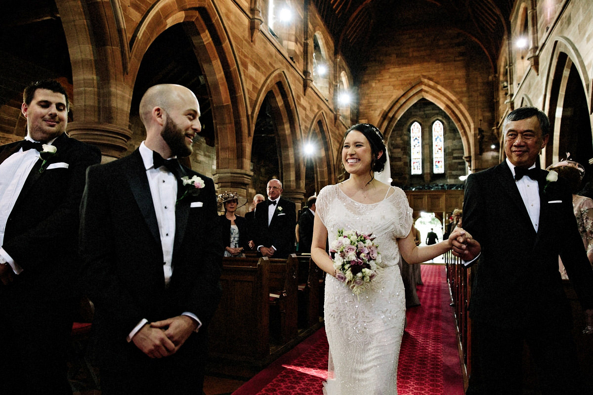 Bride seeing her groom for the first time after walking down the aisle with her father