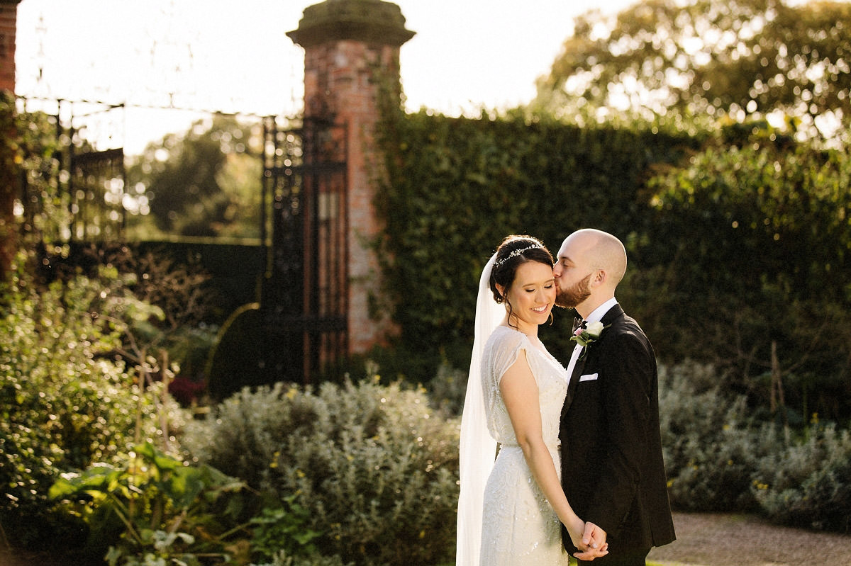 Loving moment between the bride and groom at Arley Hall and gardens