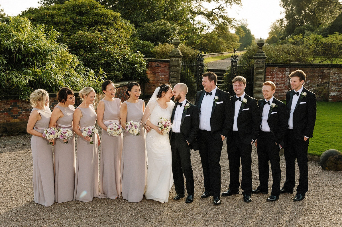 The bridal party with bridesmaids, groomsmen and the bride and groom