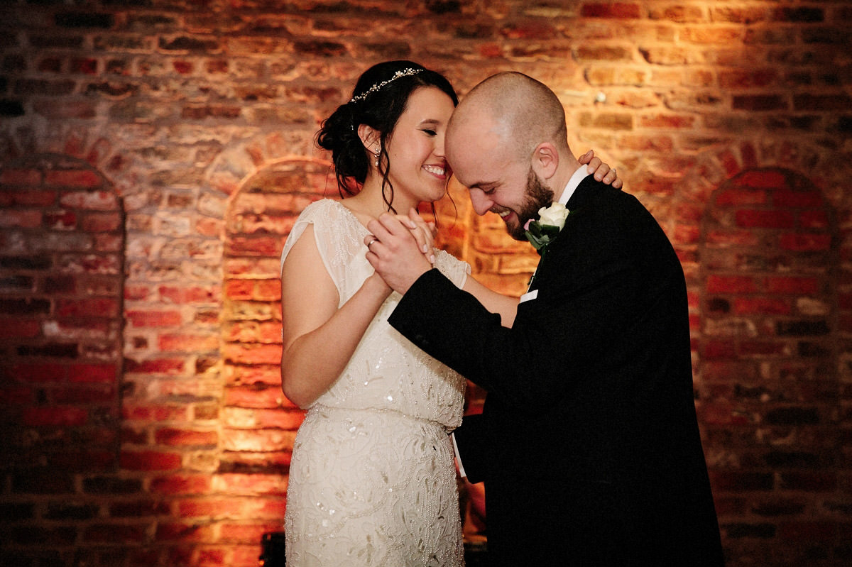Bride and grooms first dance inside the Olympia at Arley Hall