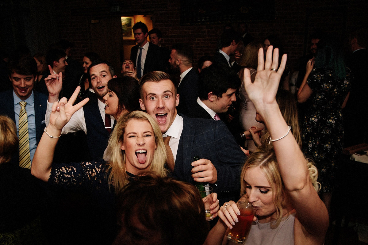 Wedding guests having fun on the dance floor at Arley Hall inside the Olympia room